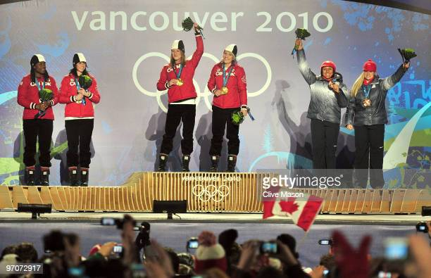 ShellyAnn Brown and Helen Upperton of Canada receive the silver medal Heather Moyse and Kaillie Humphries of Canada receive the gold medal and Elana...