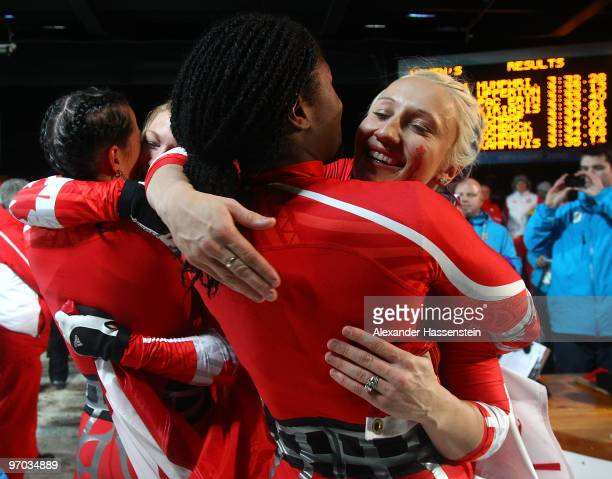 ShellyAnn Brown of Canada 2 congratulates Kaillie Humphries of Canada 1 after the women's bobsleigh on day 13 of the 2010 Vancouver Winter Olympics...
