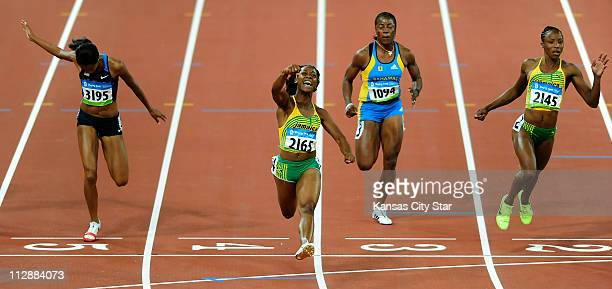 ShellyAnn Fraser of Jamaica left celebrates as she captures gold in the 100meters on Sunday August 17 in the Games of the XXIX Olympiad in Beijing...