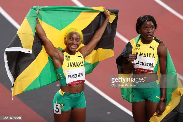 Shelly-Ann Fraser-Pryce and Shericka Jackson of Team Jamaica react after securing the silver and bronze medals in the Women's 100m Final on day eight...