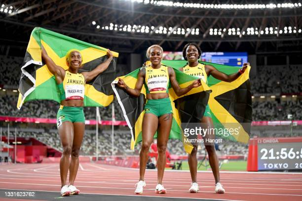 Shelly-Ann Fraser-Pryce, Elaine Thompson-Herah and Shericka Jackson of Team Jamaica celebrate after completing a podium sweep in the Women's 100m...