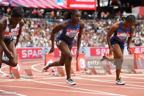 Shelly-Ann Fraser-Pryce of Jamaica and Dina Asher-Smith of Great Britain compete in the Women's 100m during Day Two of the Muller Anniversary Games...