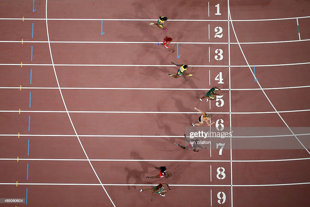 Shelly-Ann Fraser-Pryce of Jamaica (R) beats (L-R) Blessing Okagbare of Nigeria, Kelly-Ann Baptiste of Trinidad and Tobago, Tori Bowie of the United States Dafne Schippers of the Netherlands, Veronica Campbell-Brown of Jamaica, Michelle-Lee Ahye of Trinidad and Tobago and Natasha Morrison of Jamaica to win gold in the Women's 100 metres final during day three of the 15th IAAF World Athletics Championships Beijing 2015 at Beijing National Stadium on August 24, 2015 in Beijing, China.