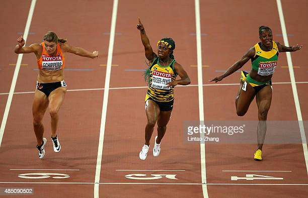 Shelly-Ann Fraser-Pryce of Jamaica beats Dafne Schippers of the Netherlands and Veronica Campbell-Brown of Jamaica to win gold in the Women's 100...