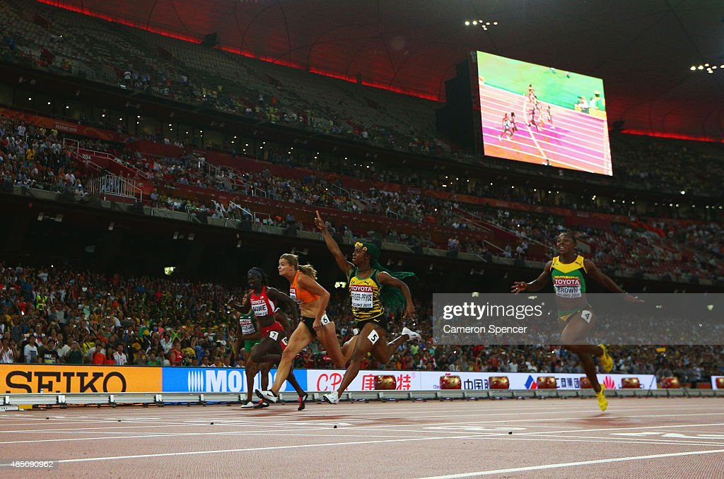 Shelly-Ann Fraser-Pryce of Jamaica (2nd R) beats Dafne Schippers of the Netherlands (2nd L) and Veronica Campbell-Brown of Jamaica (R) to win gold in the Women's 100 metres final during day three of the 15th IAAF World Athletics Championships Beijing 2015 at Beijing National Stadium on August 24, 2015 in Beijing, China.