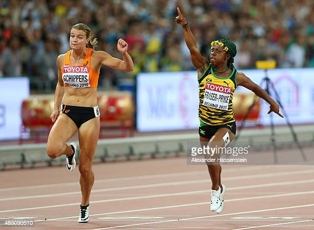Shelly-Ann Fraser-Pryce of Jamaica beats Dafne Schippers of the Netherlands to win gold in the Women's 100 metres final during day three of the 15th...