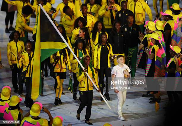 ShellyAnn FraserPryce of Jamaica carries the flag during the Opening Ceremony of the Rio 2016 Olympic Games at Maracana Stadium on August 5 2016 in...