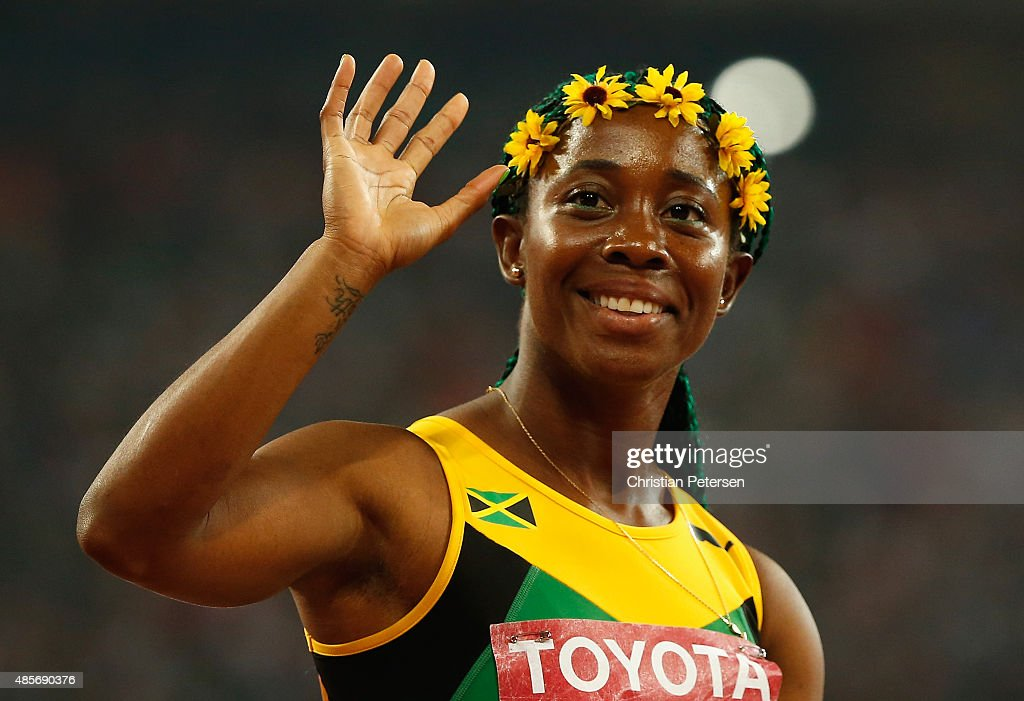 Shelly-Ann Fraser-Pryce of Jamaica celebrates after crossing the finish line to win gold in the Women's 4x100 Metres Relay final during day eight of the 15th IAAF World Athletics Championships Beijing 2015 at Beijing National Stadium on August 29, 2015 in Beijing, China.
