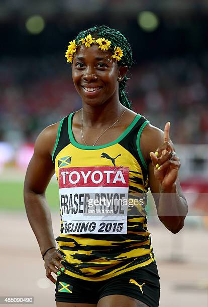 Shelly-Ann Fraser-Pryce of Jamaica celebrates after winning gold in the Women's 100 metres final during day three of the 15th IAAF World Athletics...