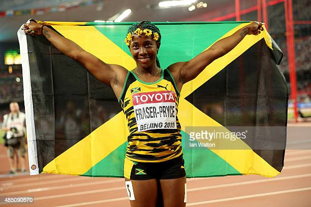 ShellyAnn FraserPryce of Jamaica celebrates after winning gold in the Women's 100 metres final during day three of the 15th IAAF World Athletics...