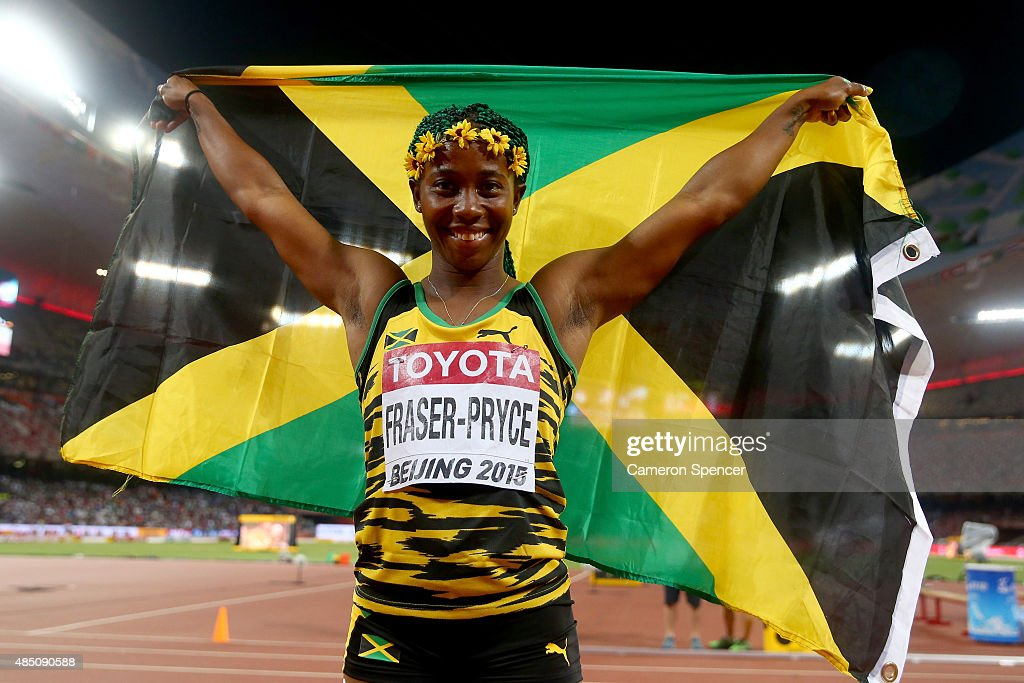 Shelly-Ann Fraser-Pryce of Jamaica celebrates after winning gold in the Women's 100 metres final during day three of the 15th IAAF World Athletics Championships Beijing 2015 at Beijing National Stadium on August 24, 2015 in Beijing, China.