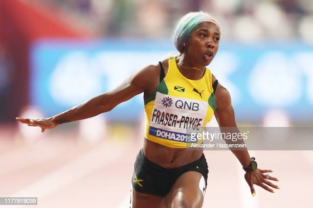 Shelly-Ann Fraser-Pryce of Jamaica celebrates winning the Women's 100 Metres final during day three of 17th IAAF World Athletics Championships Doha...