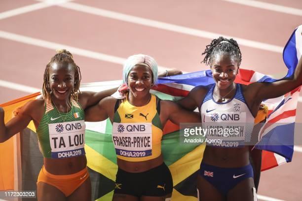 ShellyAnn FraserPryce of Jamaica celebrates winning the women's 100m final with silver medakist Dina Asher Smith of United Kingdom and bronze...
