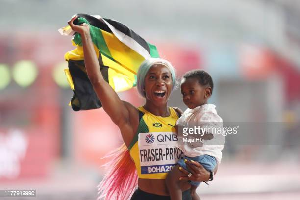 Shelly-Ann Fraser-Pryce of Jamaica celebrates with her son Zyon after winning the Women's 100 Metres final during day three of 17th IAAF World...