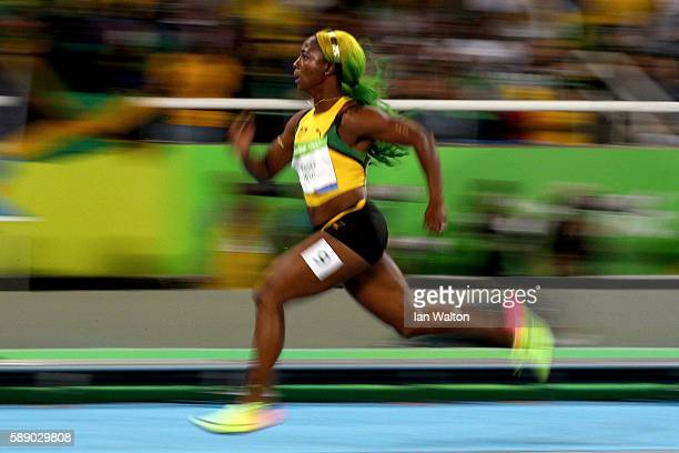 ShellyAnn FraserPryce of Jamaica competes in the Women's 100m Round 1 on Day 7 of the Rio 2016 Olympic Games at the Olympic Stadium on August 12 2016...
