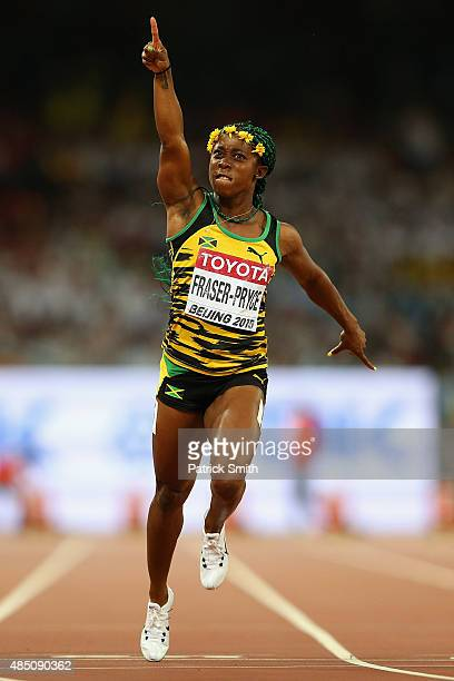 Shelly-Ann Fraser-Pryce of Jamaica crosses the finish line to win gold in the Women's 100 metres final during day three of the 15th IAAF World...