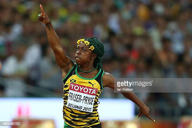 ShellyAnn FraserPryce of Jamaica crosses the finish line to win gold in the Women's 100 metres final during day three of the 15th IAAF World...