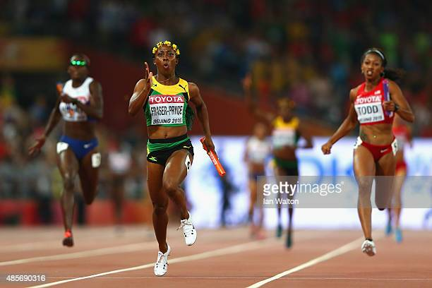 ShellyAnn FraserPryce of Jamaica crosses the finish line to win gold in the Women's 4x100 Metres Relay final during day eight of the 15th IAAF World...