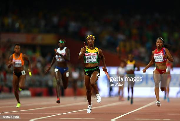 Shelly-Ann Fraser-Pryce of Jamaica crosses the finish line to win gold in the Women's 4x100 Metres Relay final during day eight of the 15th IAAF...