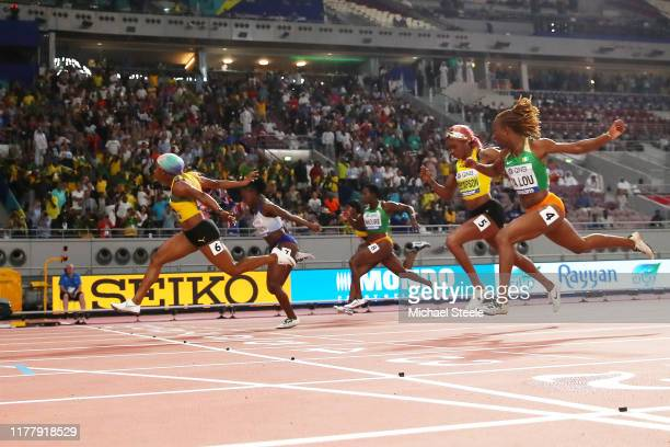 ShellyAnn FraserPryce of Jamaica crosses the finish line to win the Women's 100 Metres final in the Women's 100 Metres final during day three of 17th...