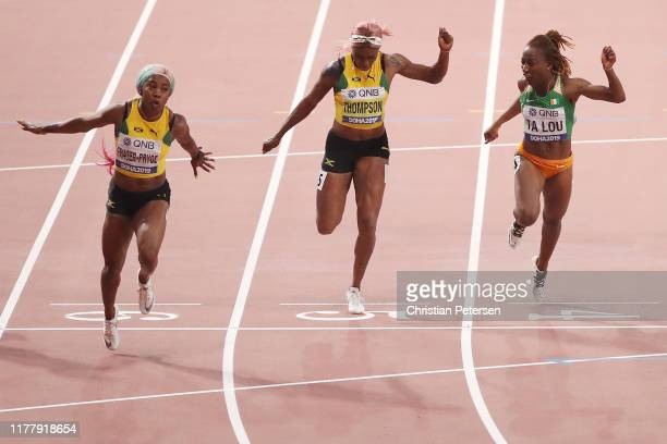 Shelly-Ann Fraser-Pryce of Jamaica crosses the finish line to win the Women's 100 Metres final ahead of Elaine Thompson of Jamaica and Marie-Josée Ta...