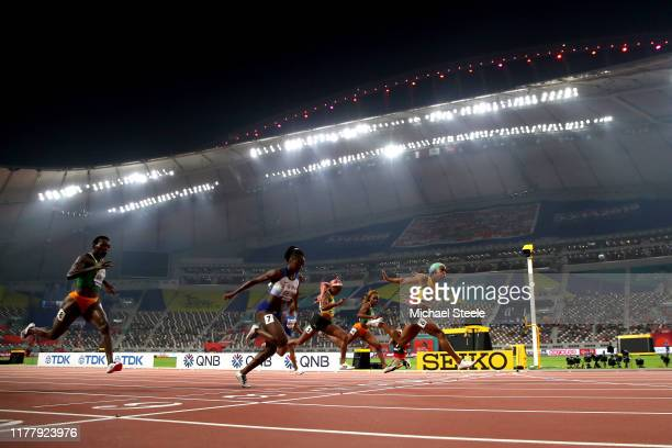Shelly-Ann Fraser-Pryce of Jamaica crosses the finish line to win the Women's 100 Metres final ahead of Dina Asher-Smith of Great Britain, Elaine...