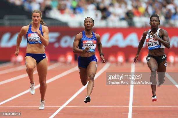 Shelly-Ann Fraser-Pryce of Jamaica , Dafne Schippers of the Netherlands and Murielle Ahoure of Ivory Coast compete in the Women's 100m Heat during...