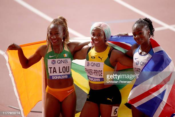 Shelly-Ann Fraser-Pryce of Jamaica, gold, Dina Asher-Smith of Great Britain, silver, and Marie-Josée Ta Lou of the Ivory Coast, bronze, celebrate...