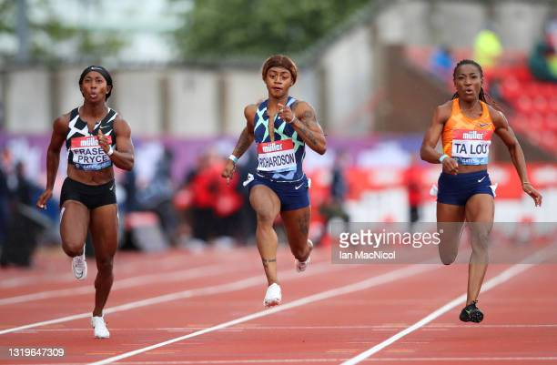 Shelly-Ann Fraser-Pryce of Jamaica, Sha'carri Richardson of the United States and Marie-Josee Ta Lou of Cote d'Ivoire compete in the Women's 100...