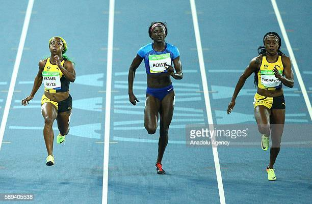 Shelly-Ann Fraser-Pryce of Jamaica, Tori Bowie of USA and Elaine Thompson of Jamaica compete during the Women's 100m Final of the Rio 2016 Olympic...