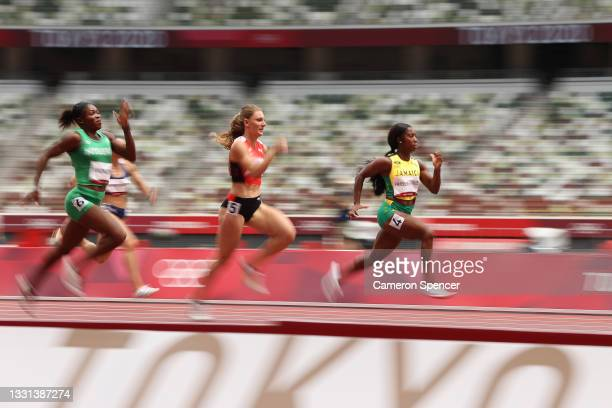 Shelly-Ann Fraser-Pryce of Team Jamaica competes during round one of the Women's 100m heats on day seven of the Tokyo 2020 Olympic Games at Olympic...