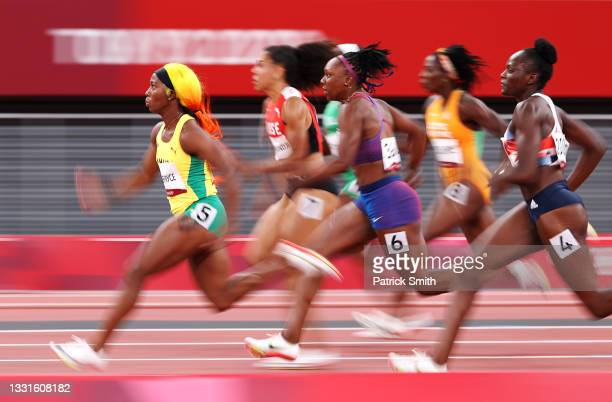 Shelly-Ann Fraser-Pryce of Team Jamaica leads her Women's 100m Semi-Final field on day eight of the Tokyo 2020 Olympic Games at Olympic Stadium on...