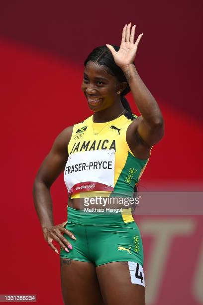 Shelly-Ann Fraser-Pryce of Team Jamaica reacts after competing during round one of the Women's 100m heats on day seven of the Tokyo 2020 Olympic...