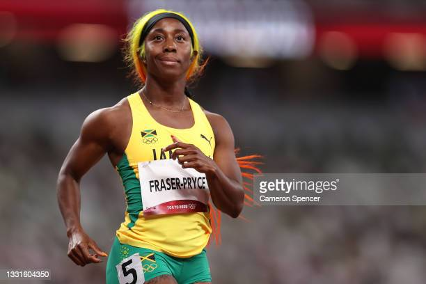 Shelly-Ann Fraser-Pryce of Team Jamaica reacts after winning her Women's 100m Semi-Final on day eight of the Tokyo 2020 Olympic Games at Olympic...