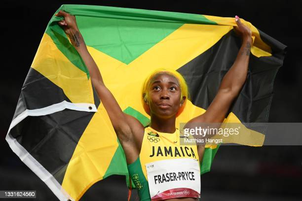 Shelly-Ann Fraser-Pryce of Team Jamaica reacts winning the silver medal in the Women's 100m Final on day eight of the Tokyo 2020 Olympic Games at...