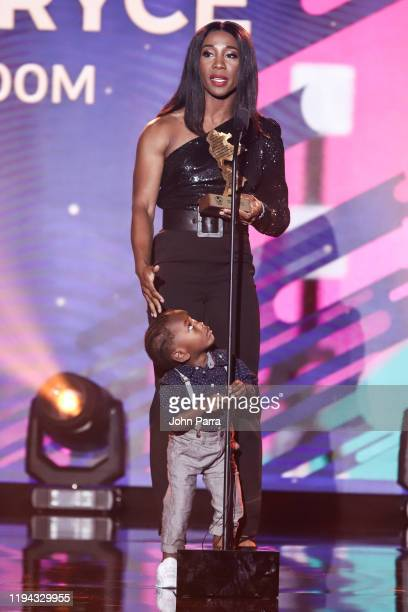 ShellyAnn FraserPryce poses with her son Zyon after receiving the Best Female Athlete award at Panam Sports Awards at Marriott Beach Resort on...
