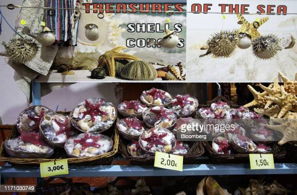 Shels and dried fish are displayed for sale at a tourist store in Hersonissos, on the island of Crete, Greece, on Tuesday, Sept. 24, 2019. Like...