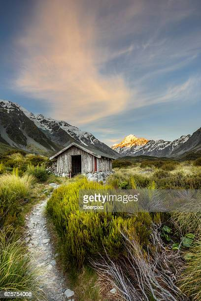 Shelter at Hooker Valley track with Mount Cook as background at Aoraki Mount Cook National Park.