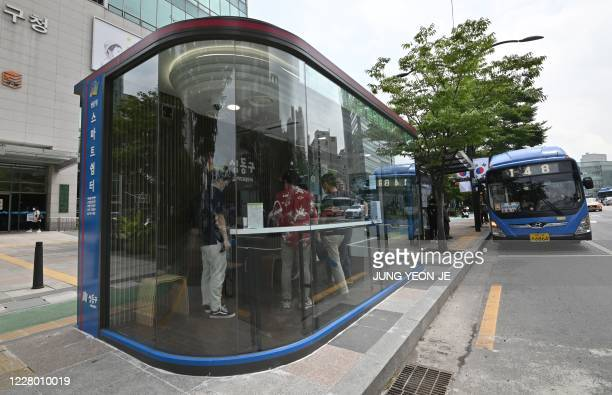 A shelter booth designed to protect passengers from monsoon rains summer heat and the COVID19 coronavirus is seen at a bus stop in Seoul on August 12...