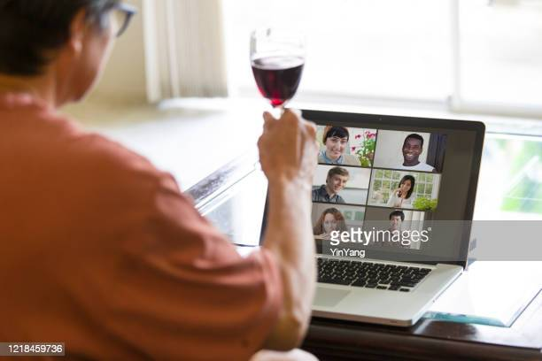 covid-19 shelter in place and social distancing in effect, virtual social life continue through live streaming, video conferencing virtual gathering - drinking stock pictures, royalty-free photos & images