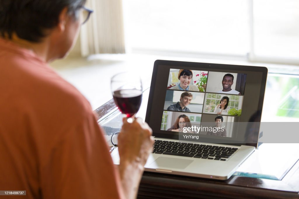COVID-19 Shelter in Place and Social Distancing in effect, Virtual Social Life Continue through Live Streaming, video Conferencing Virtual Gathering : Stock Photo
