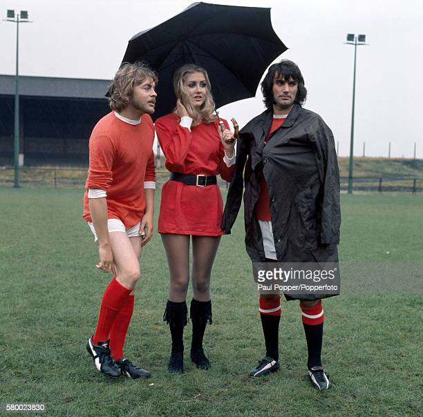 Sheltering from the weather, Manchester United footballer George Best with actor Hywel Bennett and actress Penny Brahms during the filming of 'Percy'...