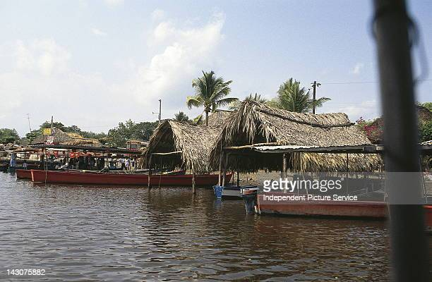 Shelters and tourist excursion boats docked at San Jose Guatemala