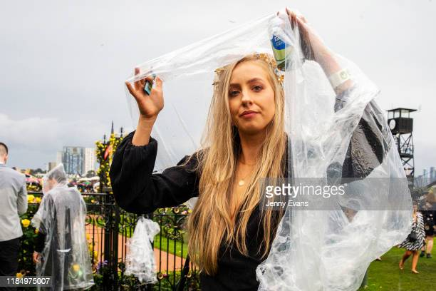 A shelters from the rain during 2019 Derby Day at Flemington Racecourse on November 2 2019 in Melbourne Australia