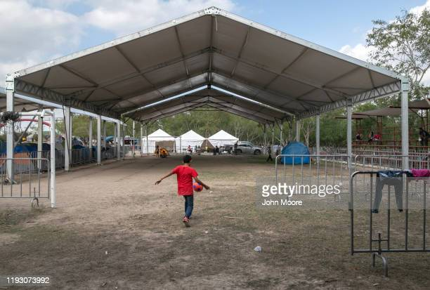Shelters known as macro tents recently constructed by the Mexican government stand virtually unused at a camp for asylum seekers on December 08 2019...