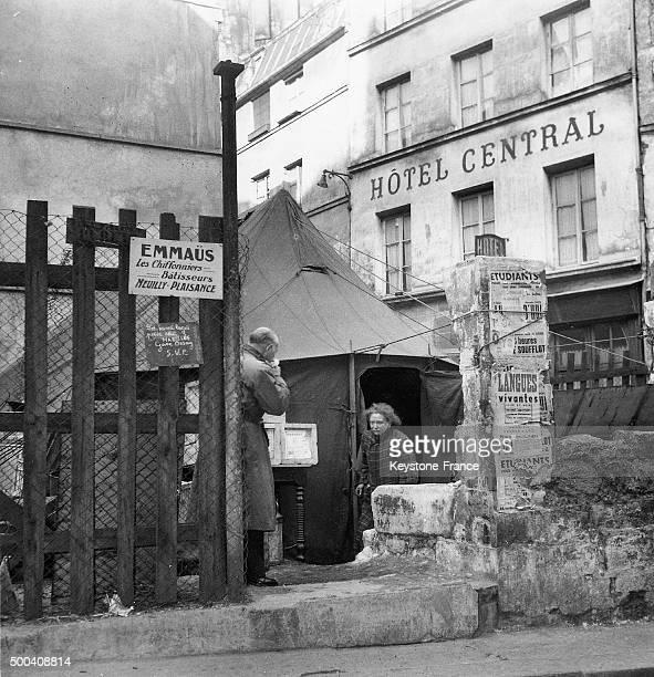 Sheltertent mounted by some of Abbe Pierre's Emmaus' movement on rue de la Montagne SainteGenevieve circa 195455 in Paris France