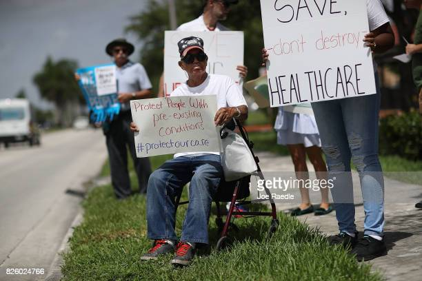 Shelton Allwood joins others for a protest in front of the office of Rep. Carlos Curbelo on August 3, 2017 in Miami, Florida. The protesters are...