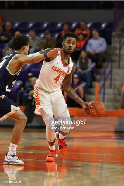 Shelton Mitchell guard of Clemson brings the ball up the court during a college basketball game between the Charleston Southern Buccaneers and the...
