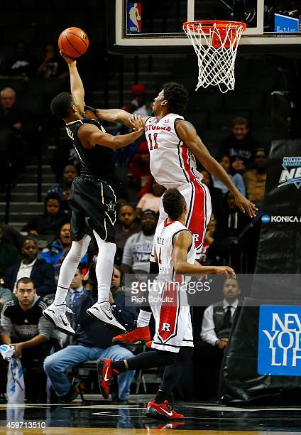 Shelton Mitchell of the Vanderbilt Commodores attempts a layup as Kadeem Jack and Myles Mack of the Rutgers Scarlet Knights defend during the second...