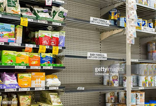 Shelves almost empty of baby formula with signs warning customers that they are limited to 8 cans per customers at a large Sydney supermarket on...